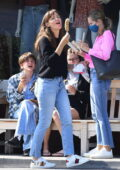 Jennifer Garner enjoys a chocolate-covered banana as she treats her kids to ice cream in Brentwood, California