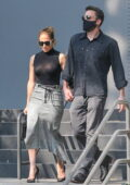 Jennifer Lopez and Ben Affleck hold hands wearing matching outfits as they go shopping together in Los Angeles