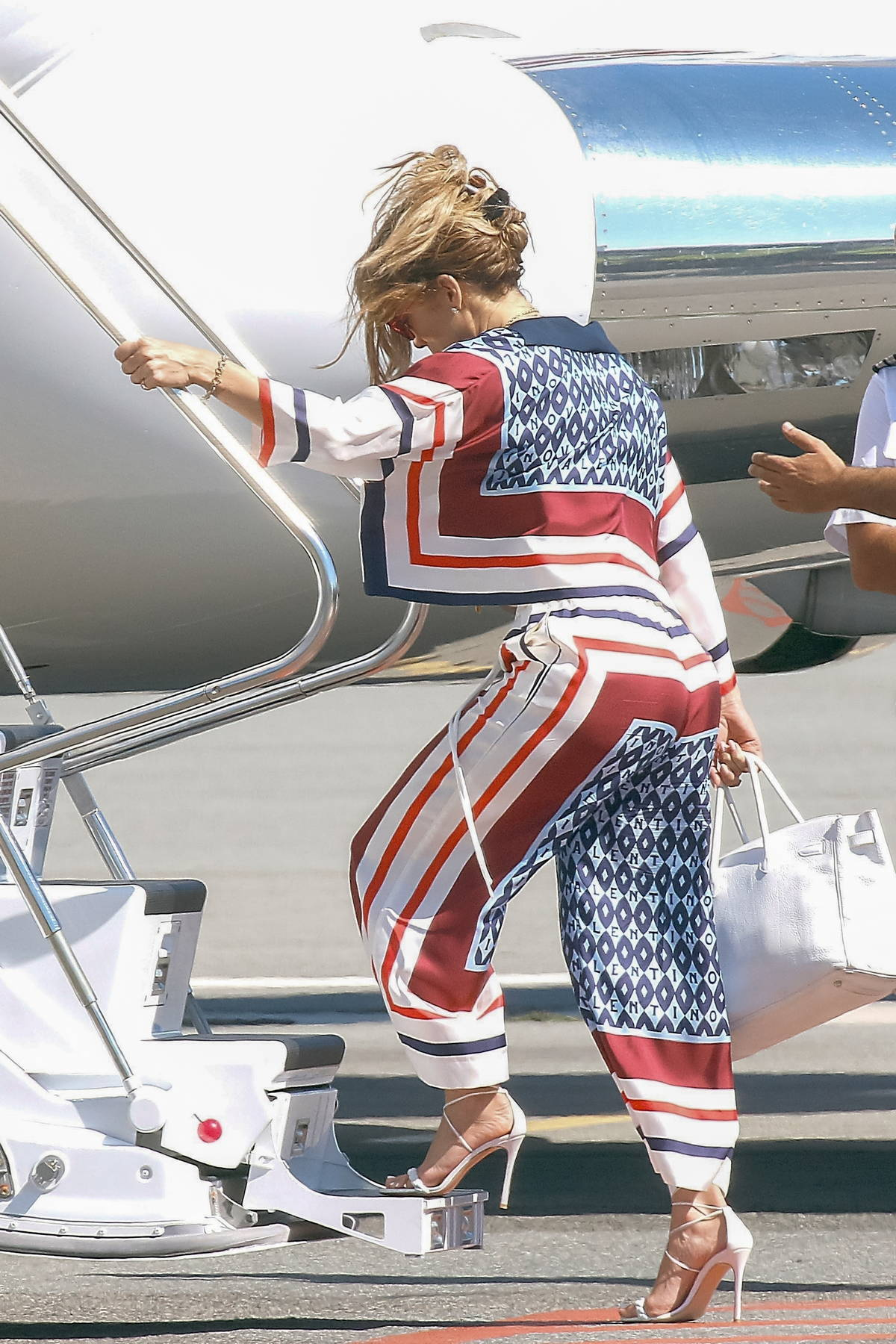 Jennifer Lopez says goodbye to her European getaway as she boards a private jet in Saint-Tropez, France