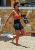 Jessica Alba displays her beach body in a bikini top and bike shorts while soaking up the sun Cabo San Lucas, Mexico
