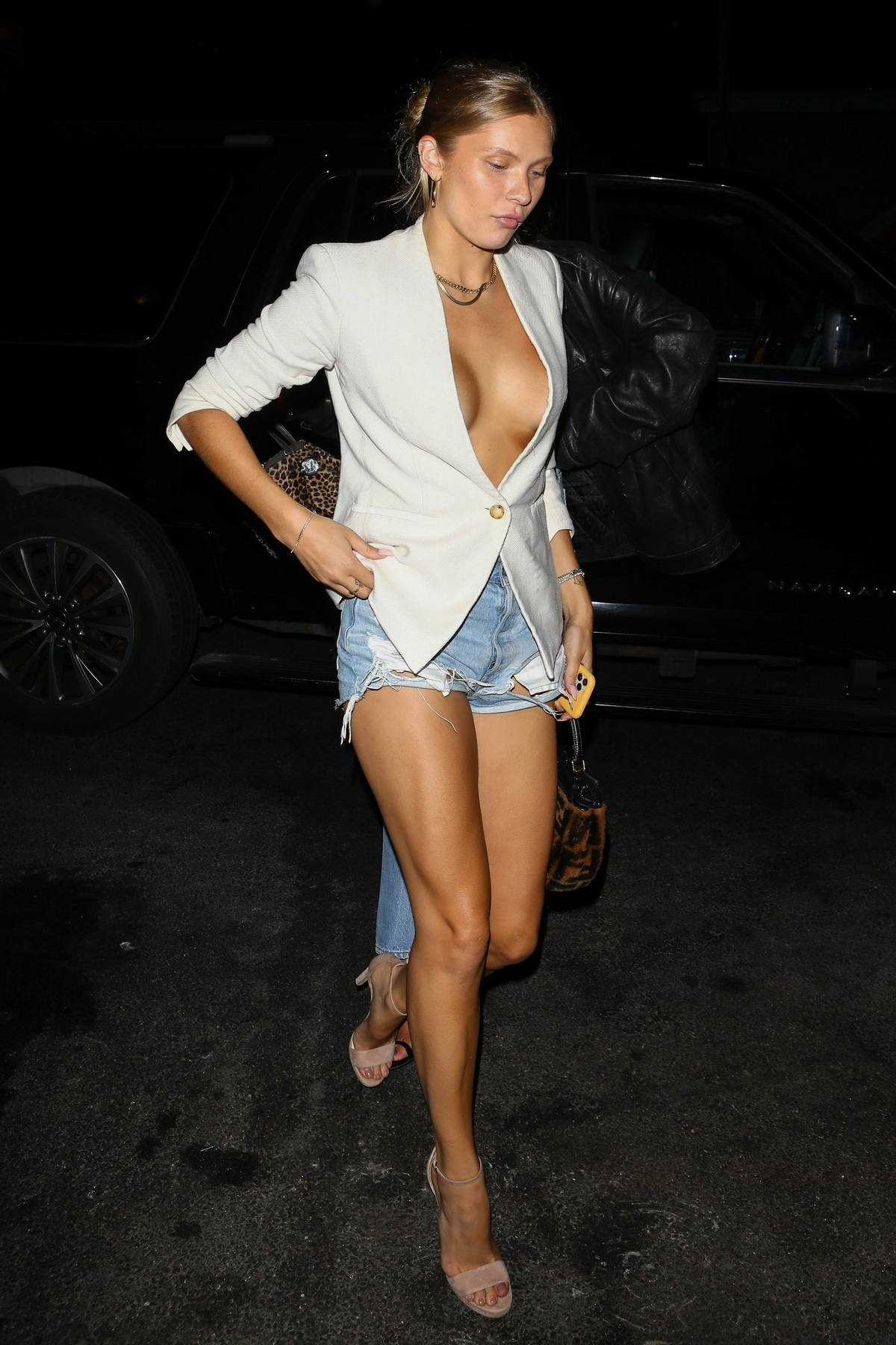 Josie Canseco displays her toned and tanned legs arriving at a launch party at Catch LA in West Hollywood, California