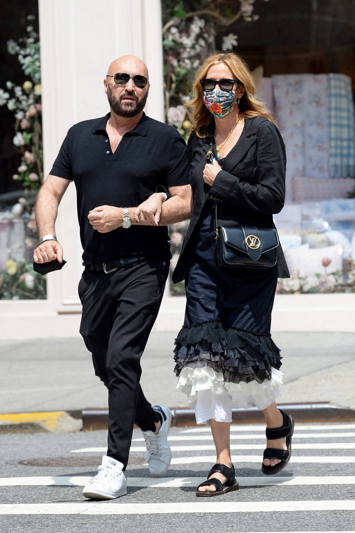 Julia Roberts walks arm in arm with her friend and hairstylist Serge Normant while out for a stroll in New York City