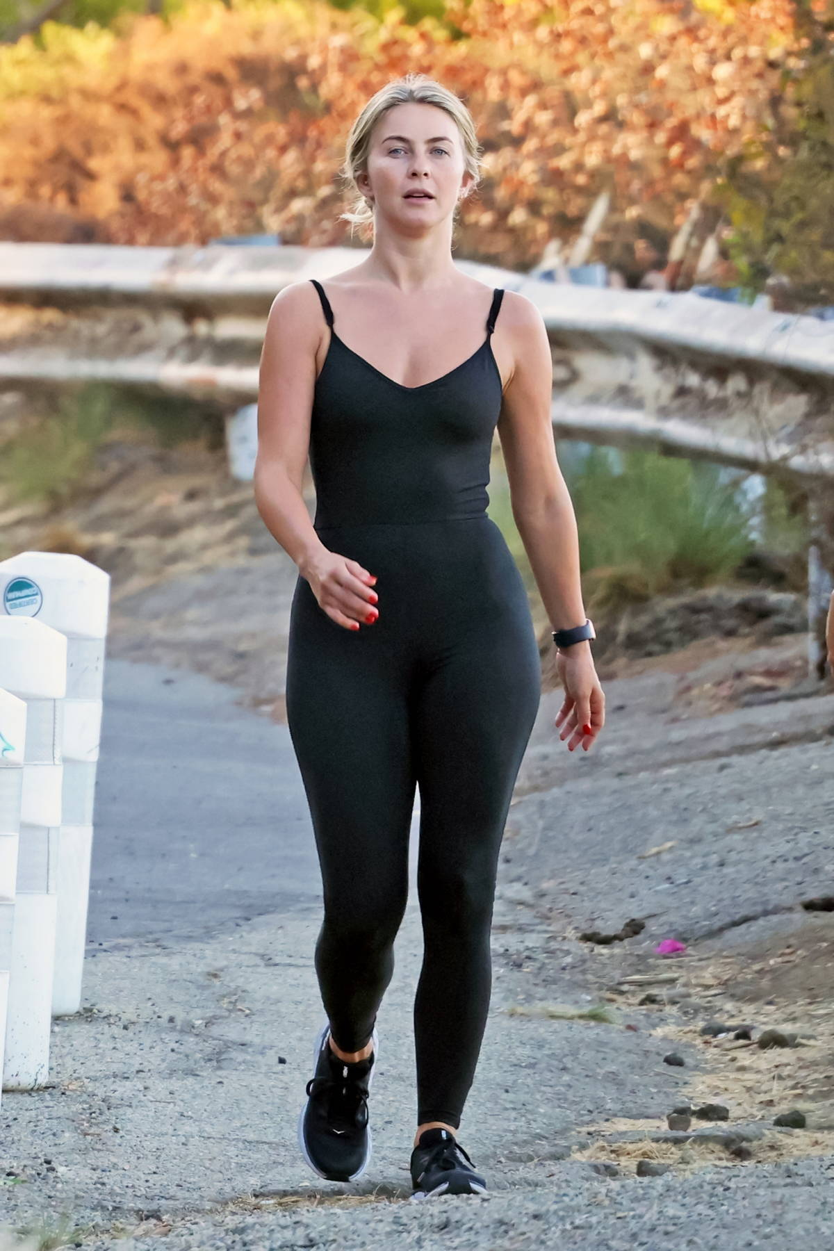 Julianne Hough sports a black top and leggings for an early morning hike with a friend in Los Angeles