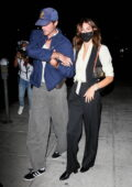 Kaia Gerber and Jacob Elordi hold onto each other while leaving their dinner date at Matsuhisa in Beverly Hills, California