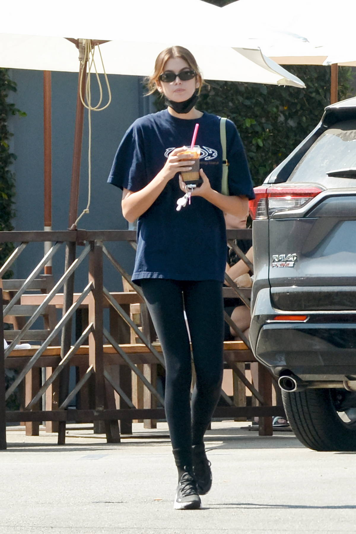 Kaia Gerber keeps it casual in a t-shirt and leggings while making a coffee run at the Coffee Commissary in Los Angeles