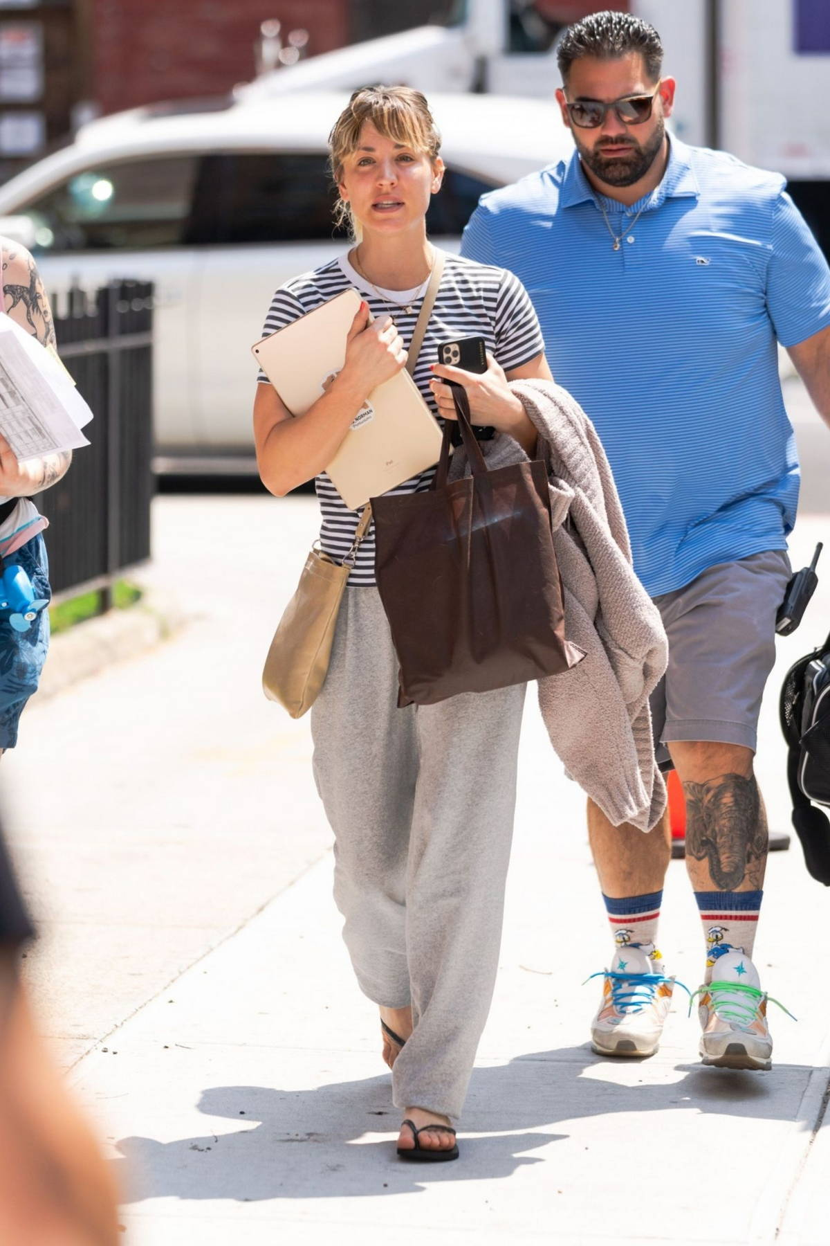 Kaley Cuoco spotted in a striped t-shirt and sweatpants while on the set 'Meet Cute' in the Brooklyn borough of New York City