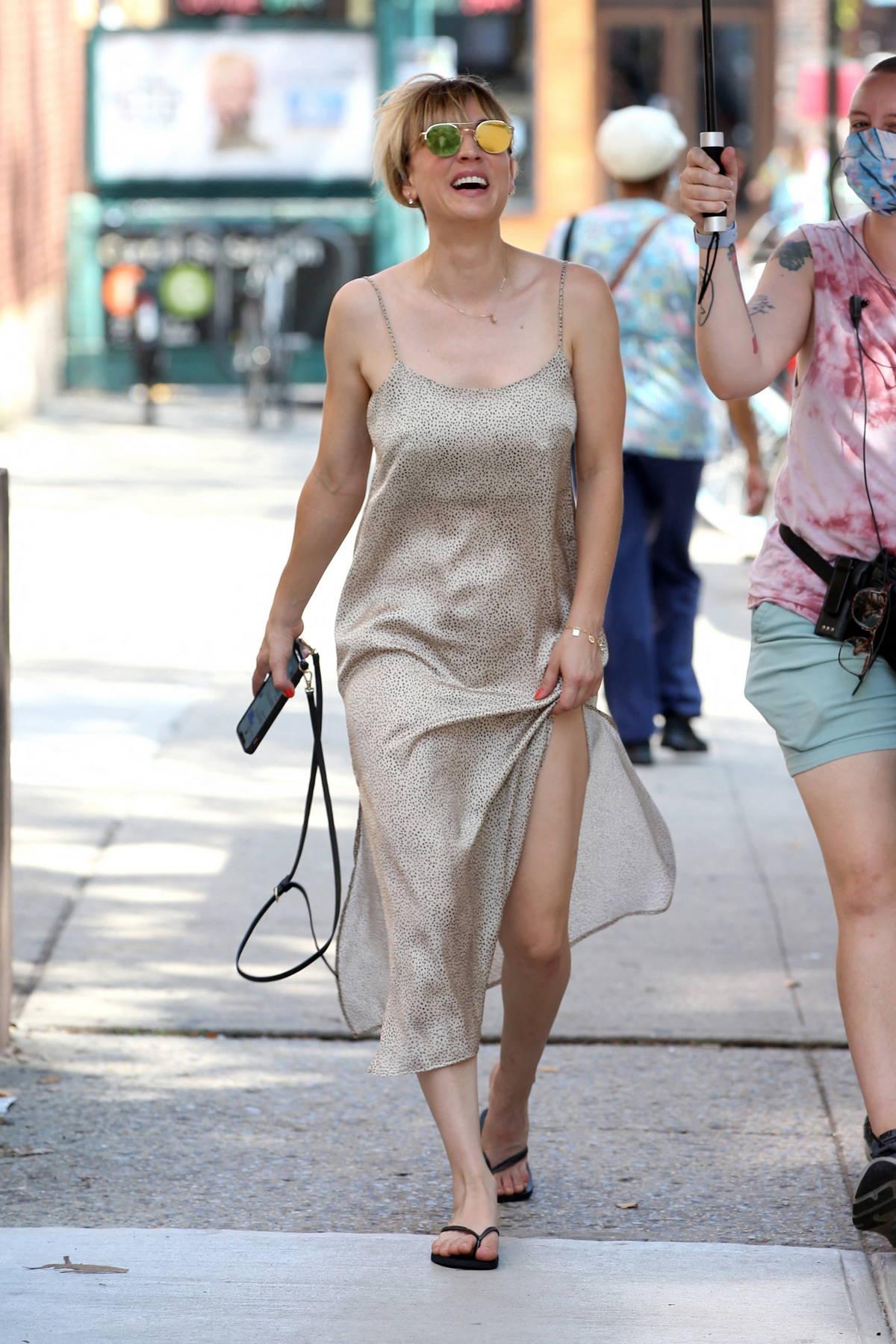 Kaley Cuoco wears a silver slip dress on the set of 'Meet Cute' in Brooklyn, New York City