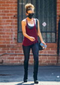Kate Beckinsale shows off her fit figure in black leggings and maroon tank top while running errands in Beverly Hills, California