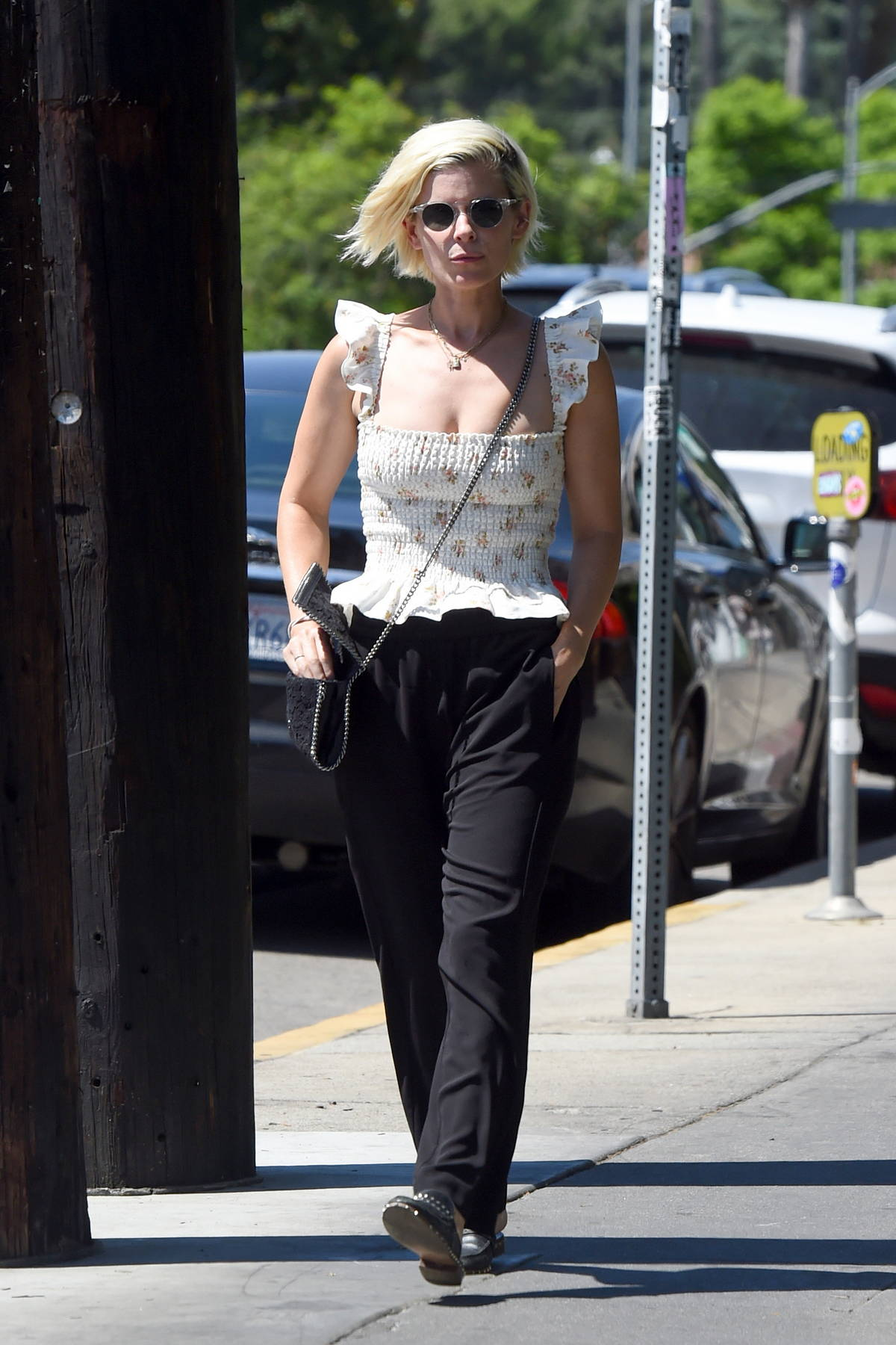 Kate Mara wears a frilly floral top and black trousers as she steps out in Los Angeles