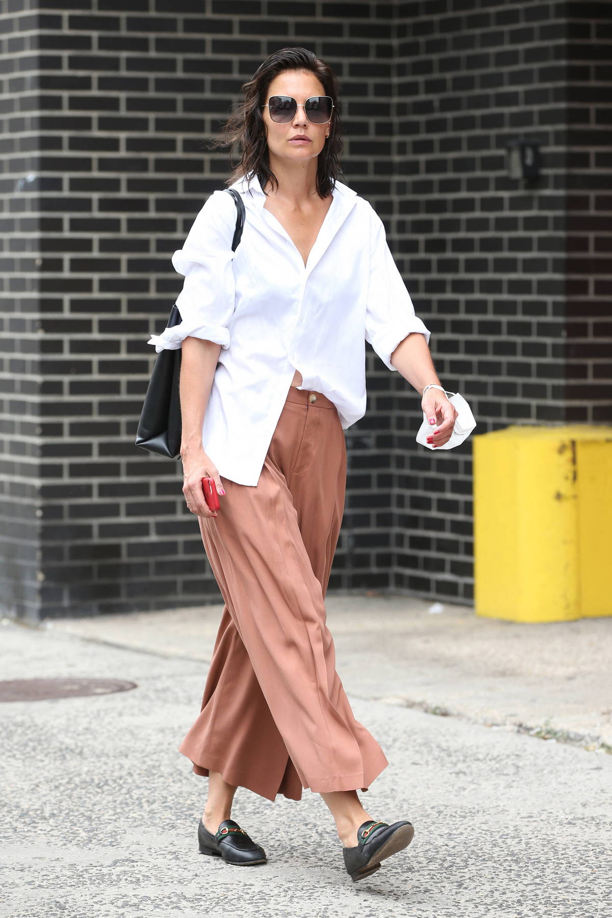 Katie Holmes looks cool in a relaxed rust pants and flowing white top in New York City