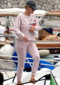 Katy Perry stays cozy in pink sweats while boarding a boat at the Port of Capri, Italy