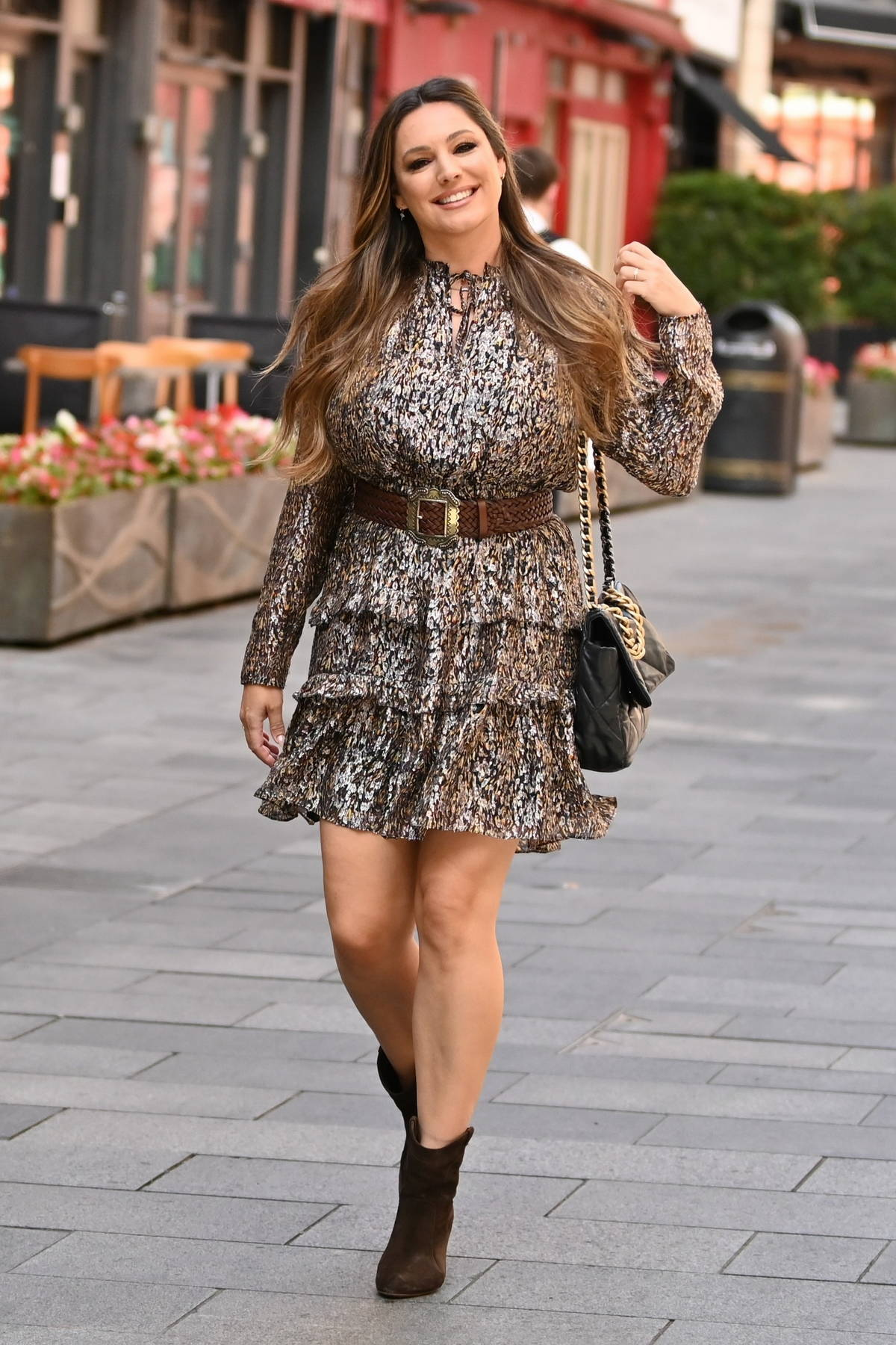 Kelly Brook dazzles in a sparkling metallic short dress as she leaves Heart radio in London, UK