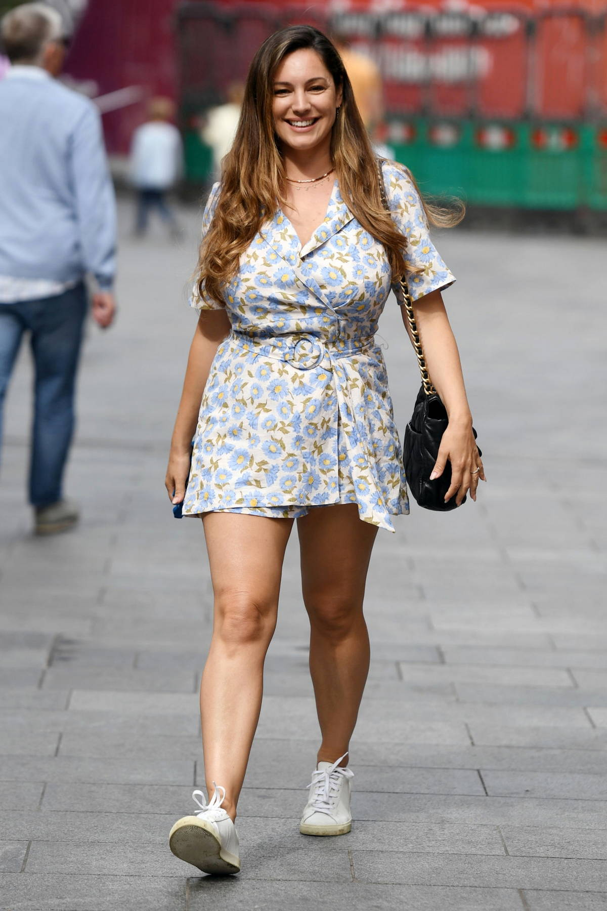 Kelly Brook looks cute in a shorts floral print dress while leaving Heart Radio studios in London, UK