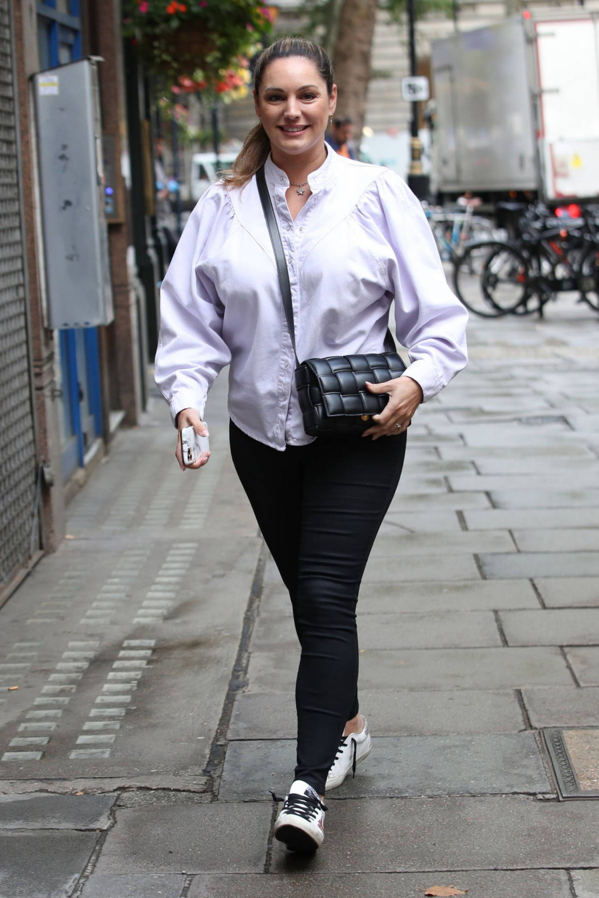 Kelly Brook looks great in a soft lavender shirt and black skin-tight jeans at the Global Radio studios in London, UK