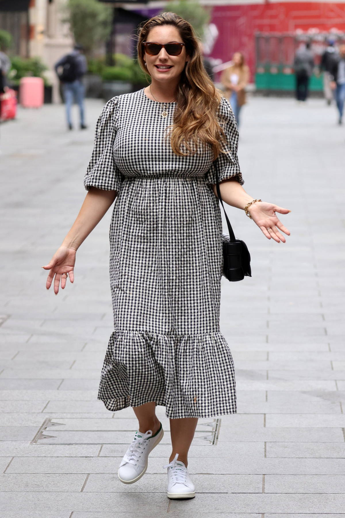 Kelly Brook looks pretty in gingham dress as she leaves Heart Radio and goes shopping with boyfriend Jeremy Parisi in London, UK
