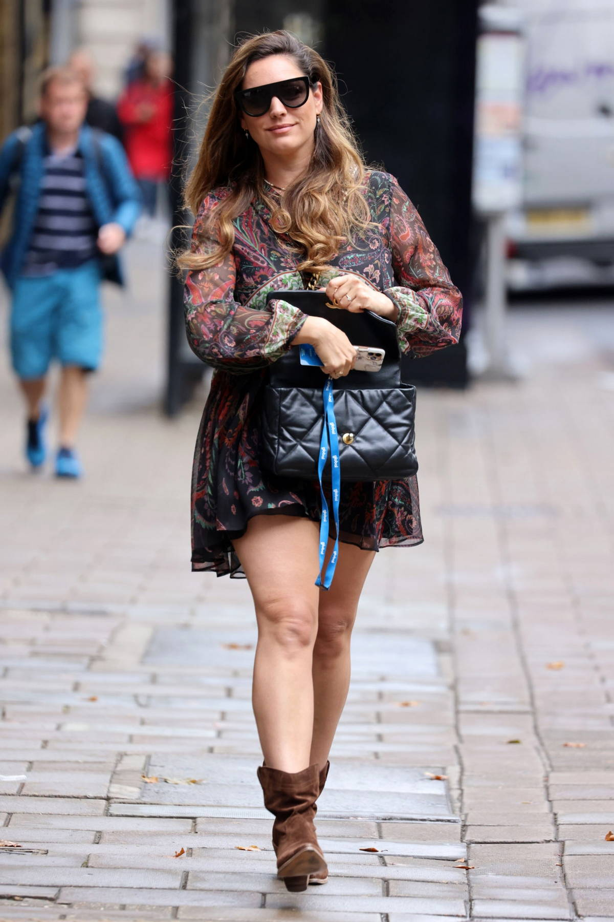 Kelly Brook looks stylish in a floral print mini dress and suede boots while leaving Heart Radio in London, UK
