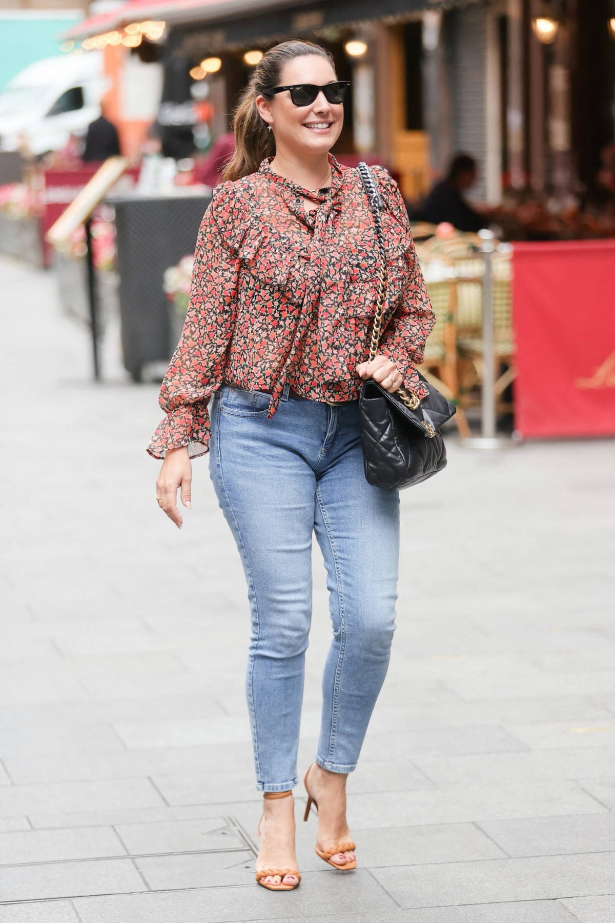 Kelly Brook rocks a pair of skin-tight jeans and floral blouse as she leaves Heart radio in London, UK