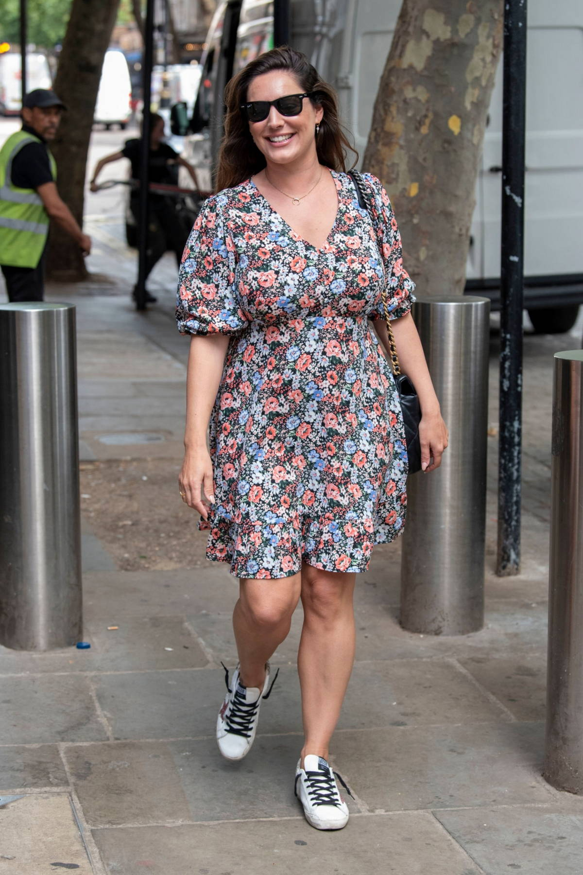 Kelly Brook wears a floral dress as she leaves the Global Studios after her breakfast show on Heart Radio in London, UK