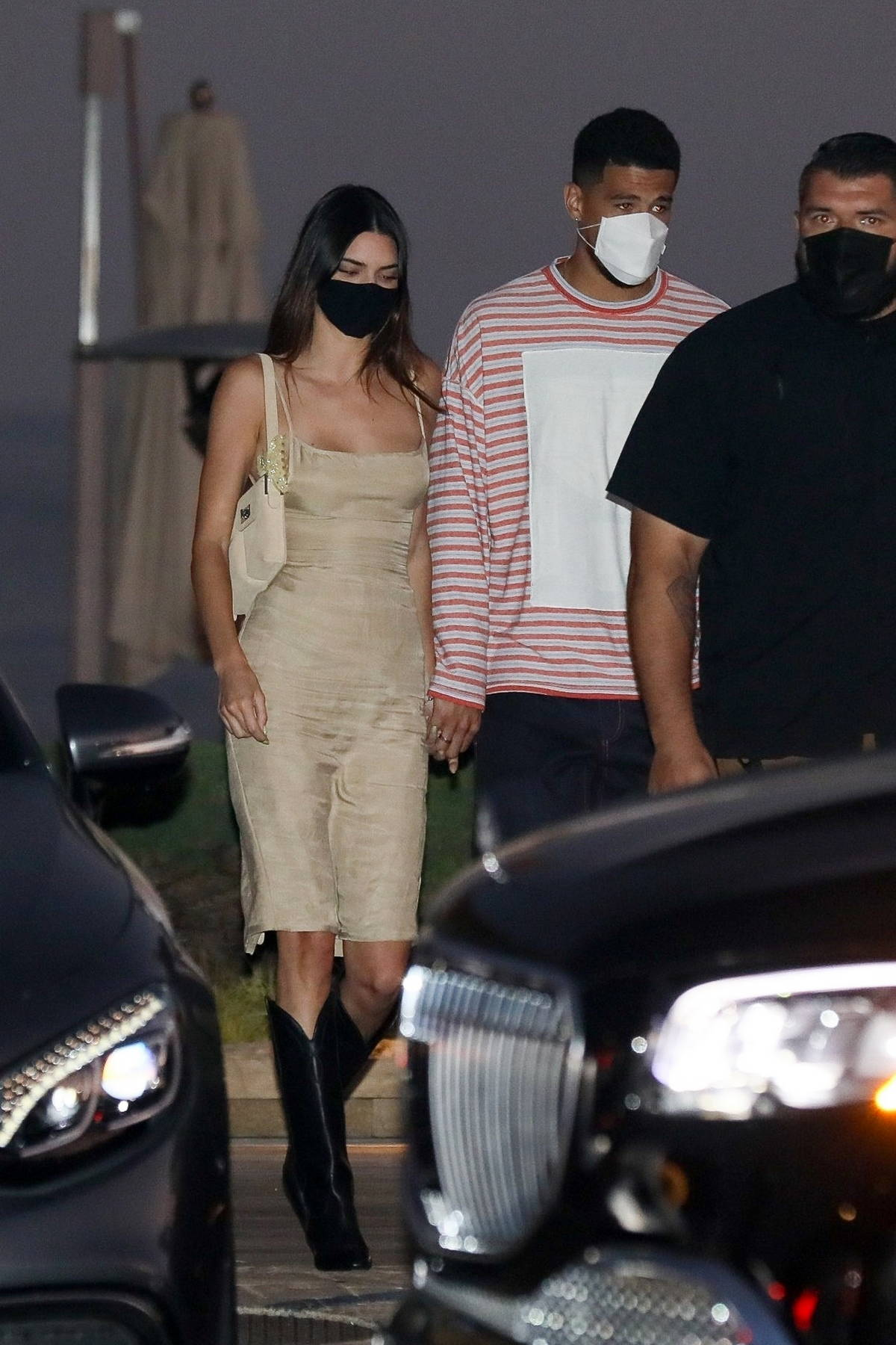 Kendall Jenner and Devin Booker hold hands as they leave Nobu after enjoying a dinner date in Malibu, California