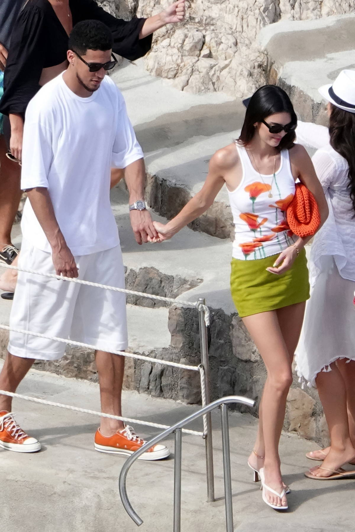 Kendall Jenner looks cute in a floral print vest top and a green mini skirt while out for lunch with Devin Booker in Salerno, Italy
