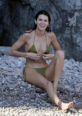 Kendall Jenner shows off her incredible toned body in a green bikini while holidaying with boyfriend Devin Booker and friends in Ponza, Italy