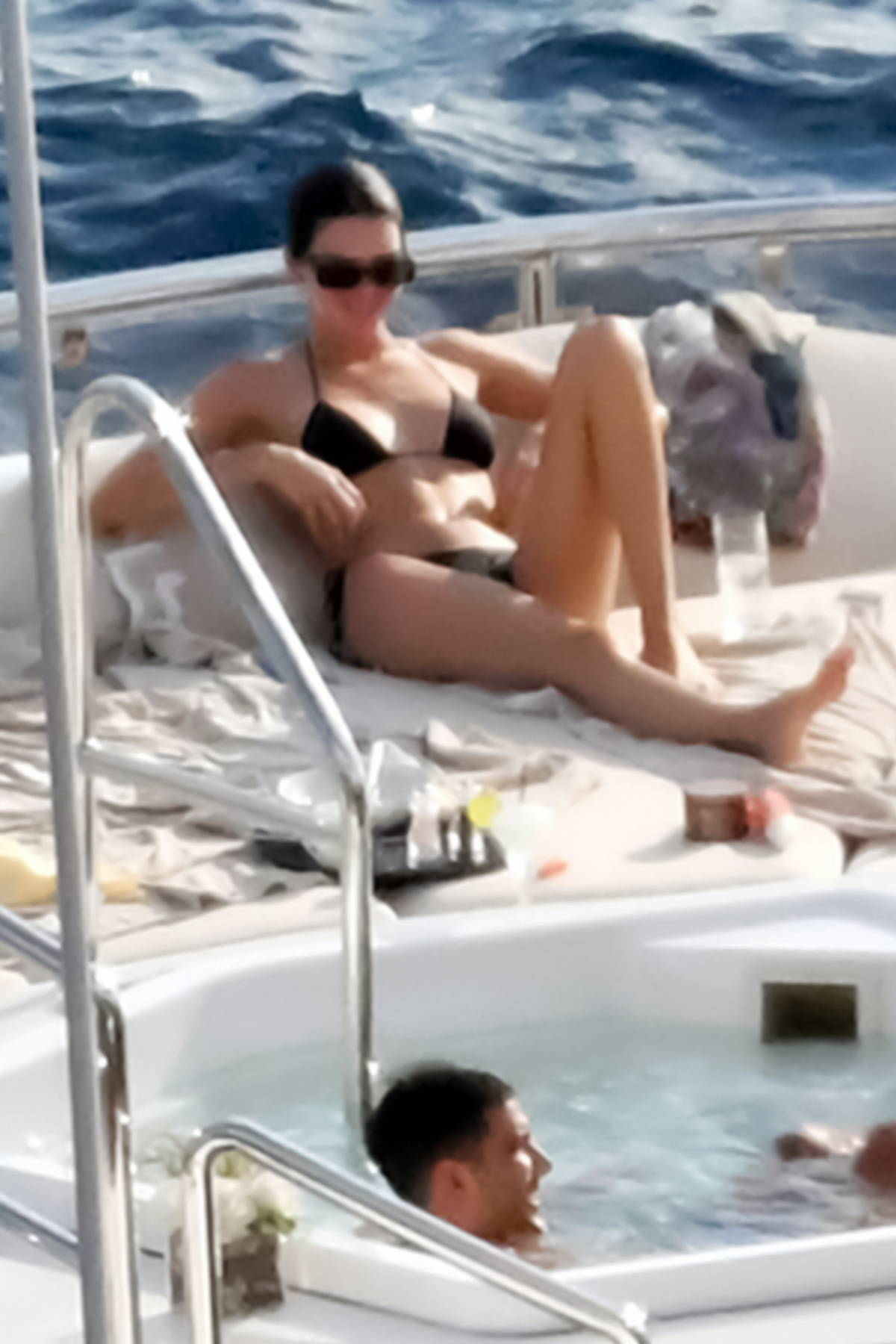 Kendall Jenner stuns in a black bikini while packing on the PDA with boyfriend Devin Booker during their vacation in Positano, Italy