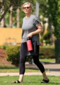 Kirsten Dunst wears a grey t-shirt and black leggings as she leaves a Pilates class in West Hollywood, California