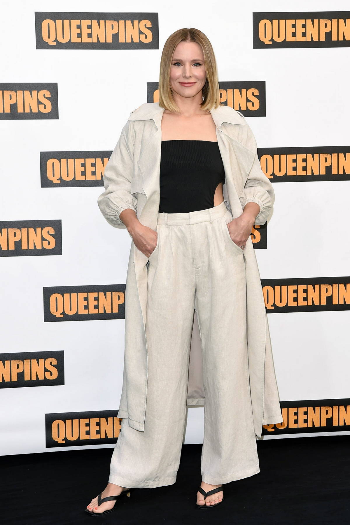 Kristen Bell attends the Photocall for 'Queenpins' at Four Seasons Hotel at Beverly Hills in Los Angeles