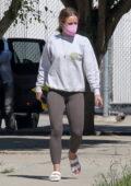 Kristen Bell wears a grey sweatshirt and brown leggings while running a few errands in Los Feliz, California