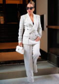 Lady Gaga dons a pinstriped white pantsuit as she arrives for rehearsals at Radio City Music Hall in New York City