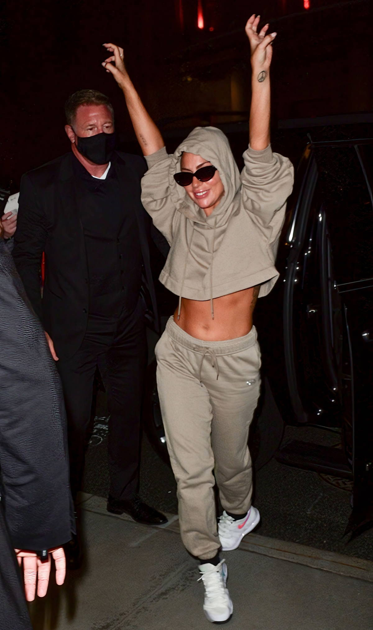Lady Gaga flashes her taut tummy during a night out in Manhattan, New York City