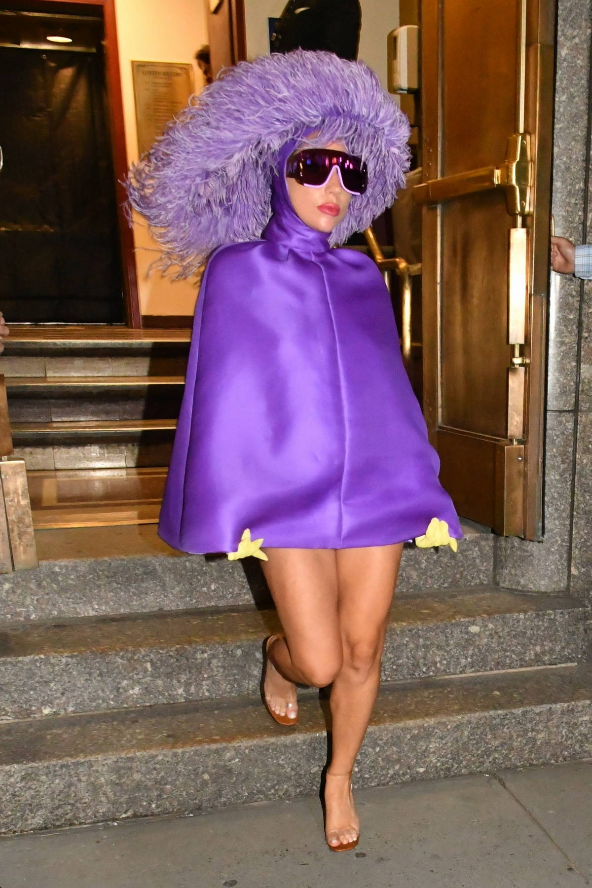 Lady Gaga showcases her unique style in all purple ensemble as she leaves Radio City Music Hall in New York City