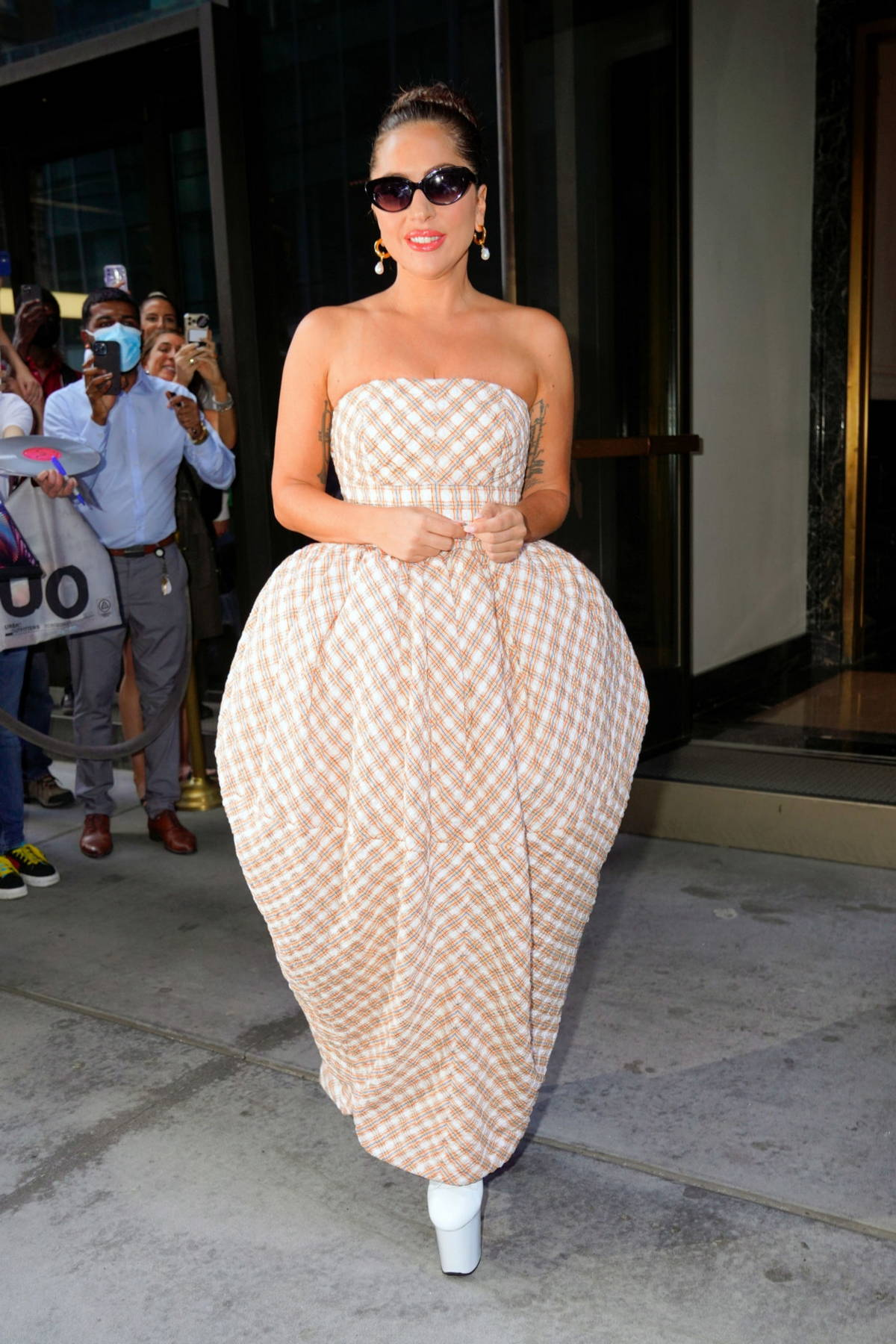 Lady Gaga stands out in a stylish puffy dress as she leaves her hotel and heads to Radio City Music Hall in New York City