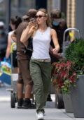 Lily-Rose Depp wears a tank top and cargo pants while out shopping with friends at Sephora in New York City