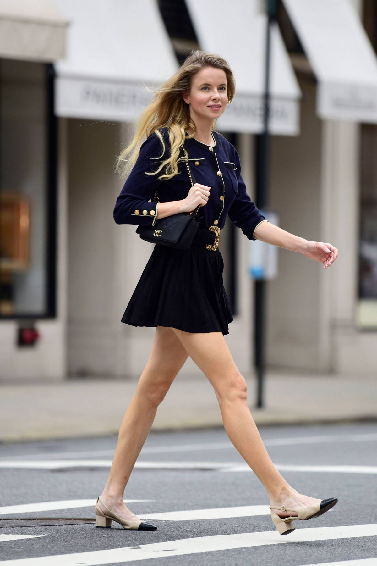 Louisa Warwick puts on a leggy display in a black mini skirt while stepping out in New York City