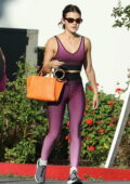 Lucy Hale displays her taut physique in a set of purple sports bra and leggings while leaving a yoga class in Los Angeles