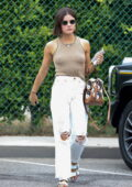Lucy Hale dons a form-fitting tank top and distressed denim while stopping by her stylists' office in Beverly Hills, California