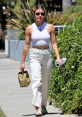 Lucy Hale dons a tight white crop top and jeans while out on a shopping trip in Los Angeles