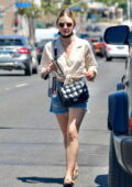 Lucy Hale looks cute in a knotted shirt and denim shorts while out running errands in Los Angeles