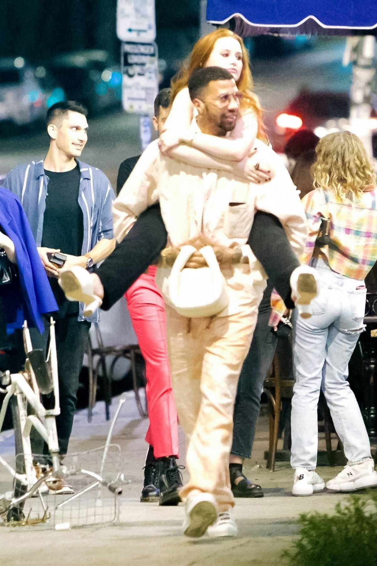 Madelaine Petsch gets a piggyback ride on her boyfriend Miles Chamley-Watson during a date night in Los Feliz, California
