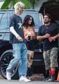 Megan Fox pays a visit to her boyfriend Machine Gun Kelly's video shoot in Los Angeles