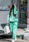 Megan Fox wears green tie-dye sweats with a hat and mask as she leaves a skincare clinic in Beverly Hills, California