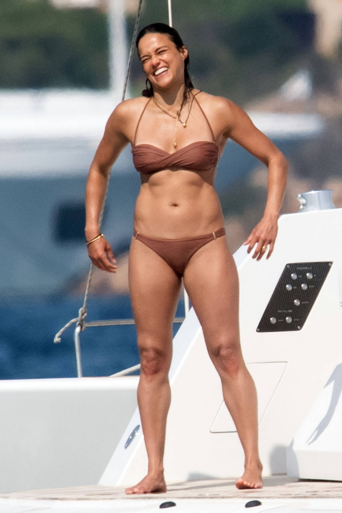 Michelle Rodriguez shows off her bikini body as she soaks up the sunshine on a yacht while holidaying in Porto Cervo, Italy