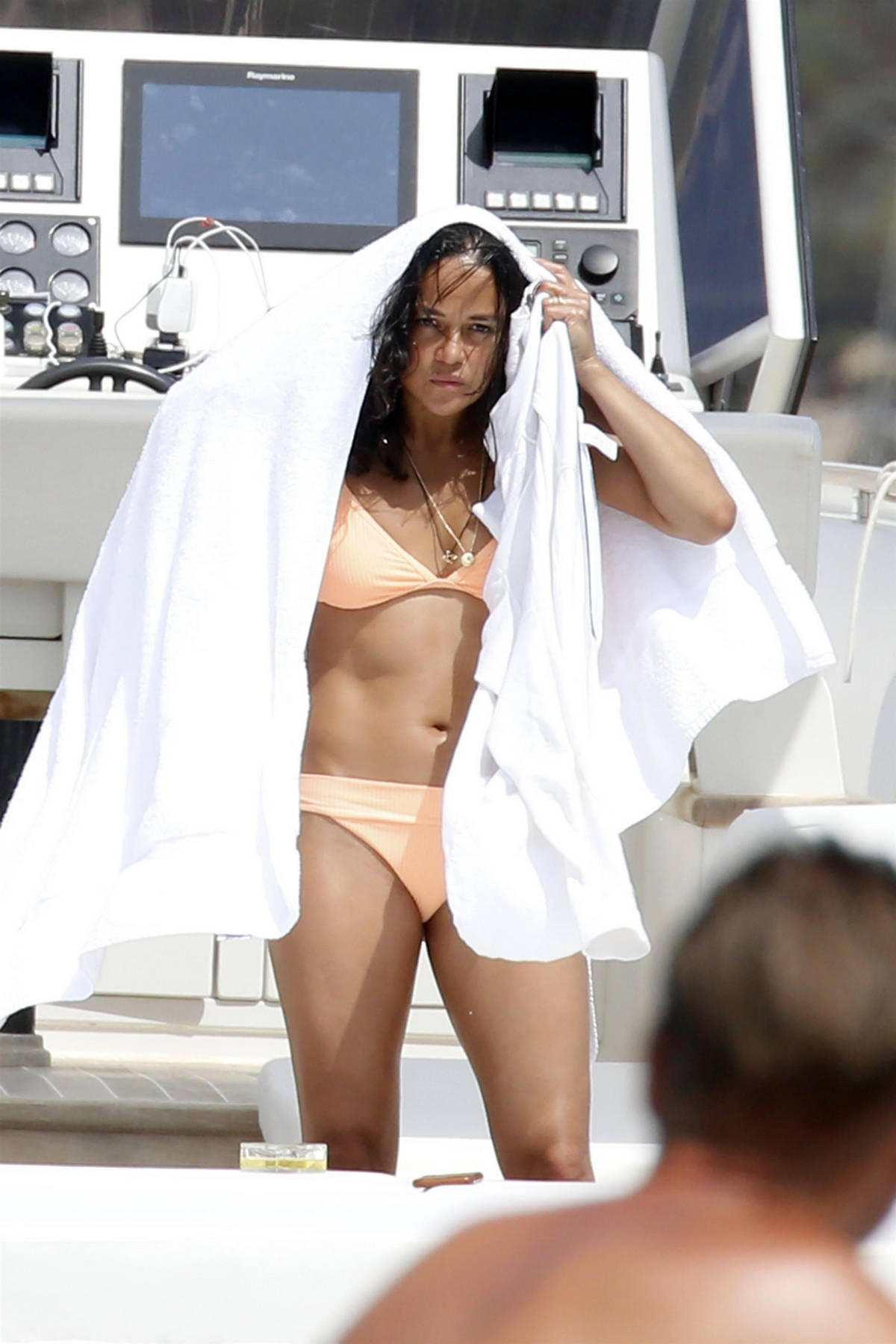 Michelle Rodriguez spotted in a peach bikini while relaxing on a yacht in Sardinia, Italy