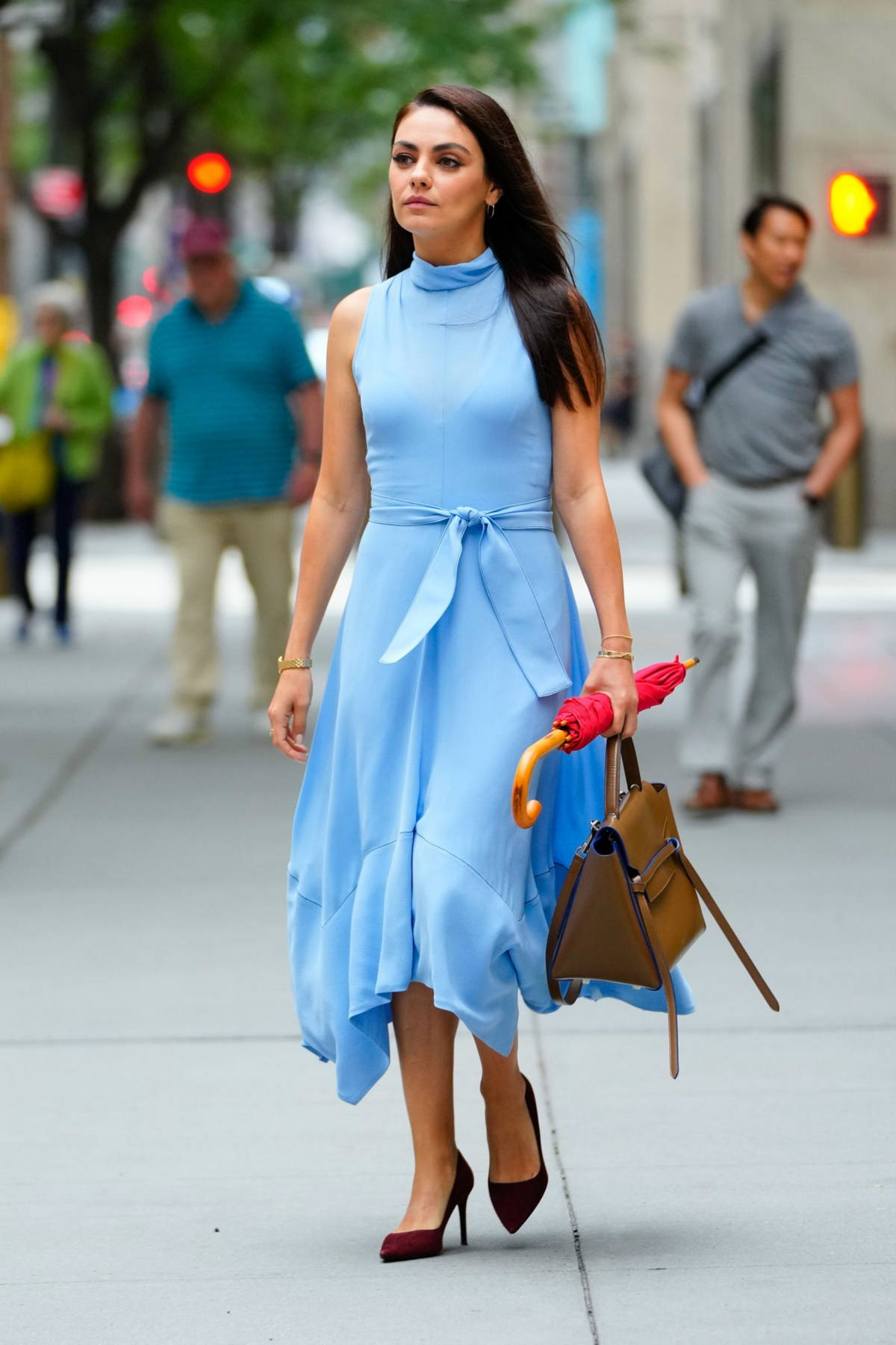 Mila Kunis looks lovely in a baby blue dress while filming 'The Luckiest Girl Alive' in New York City