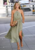 Mollie King looks great in a thigh skimming green halter neck dress while stepping out in London, UK