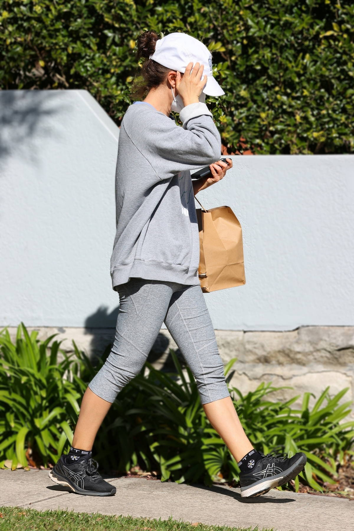 Natalie Portman dons a grey sweatshirt with matching leggings while out in Sydney, Australia