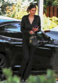 Nina Dobrev looks stylish in all-black as she arrives at a friend's house in Beverly Hills, California