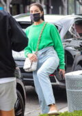 Olivia Culpo meets up with a friend as she leaves a hair salon with wet hair in West Hollywood, California