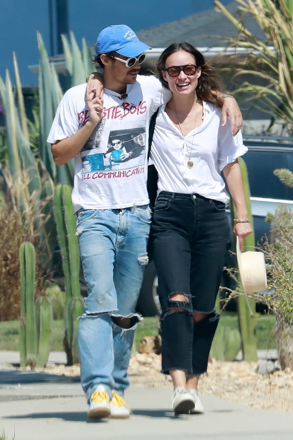 Olivia Wilde and Harry Styles wrap their arms around each other while enjoying a walk after lunch in Los Feliz, California